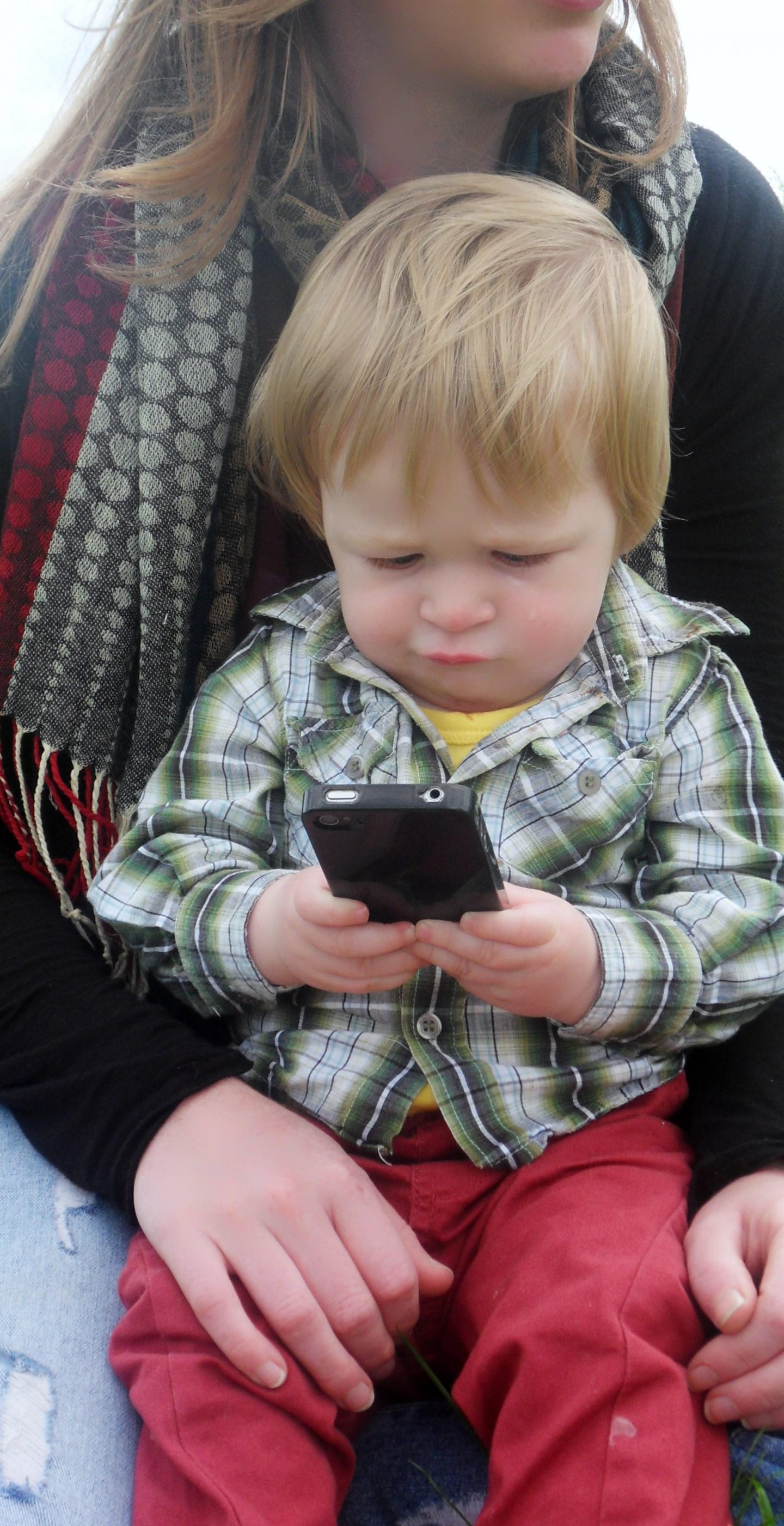 Little boy playing with a phone