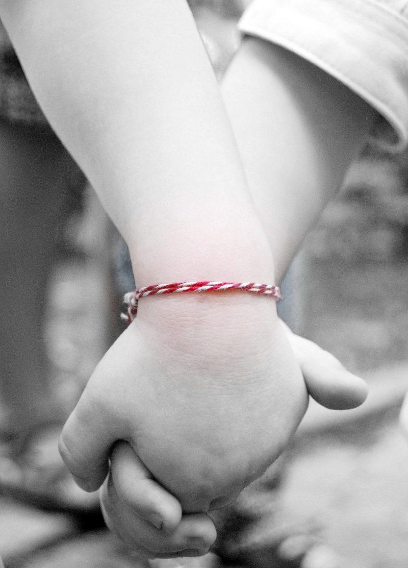 Two chidren holding hands
