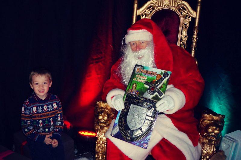 Little boy sitting with Santa