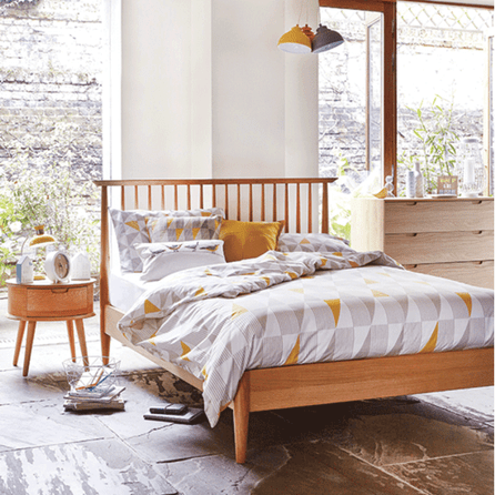bed with mismatched cushions