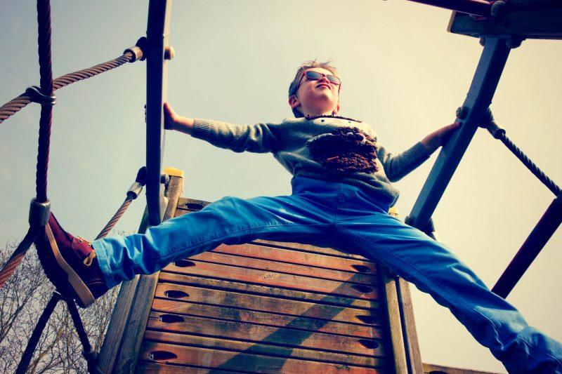 Little boy on a climbing frame