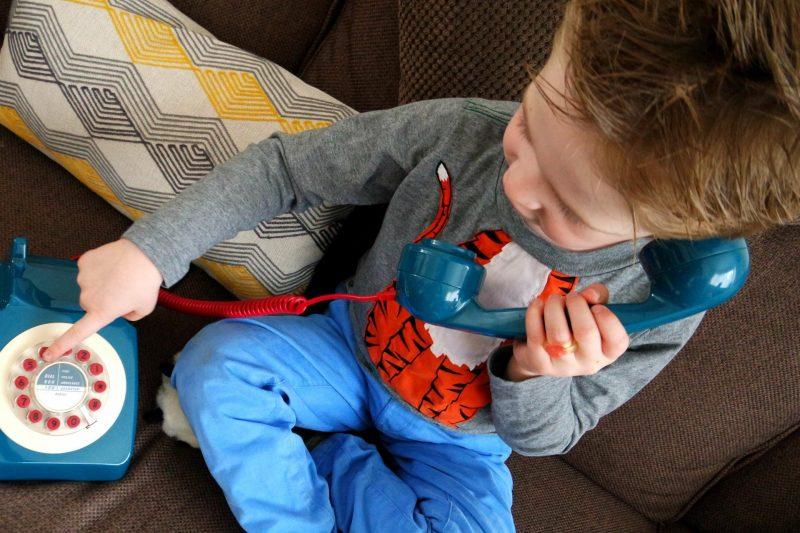 bot holding blue phone