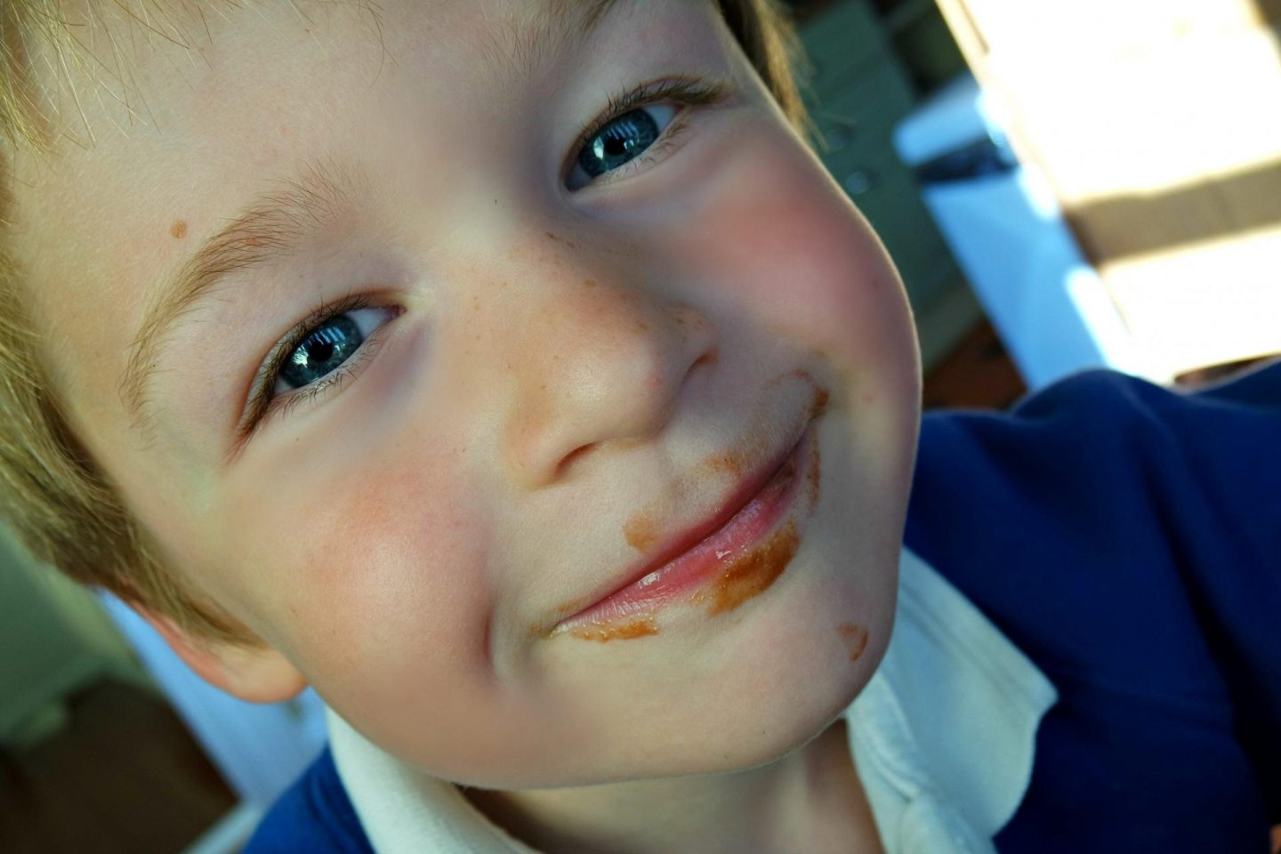 little boy with chocolatey face