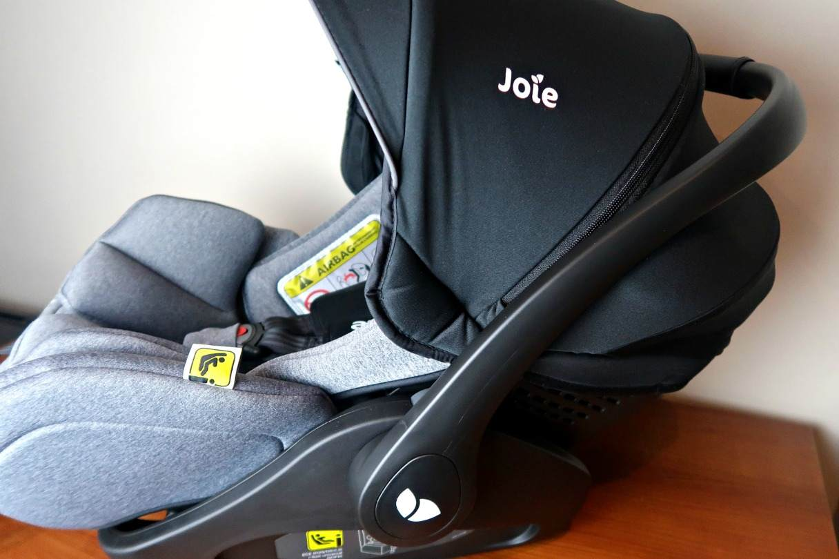 Joie Car seat side view with sun cover pulled up