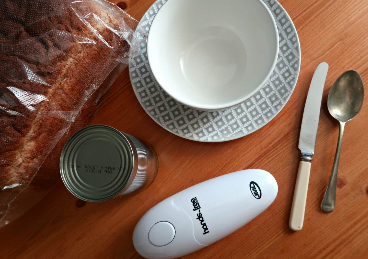 JML hands free tin opener with bread and plates