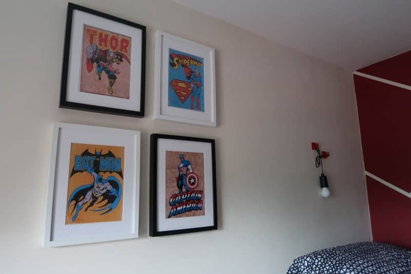 Superhero photoframes on wall