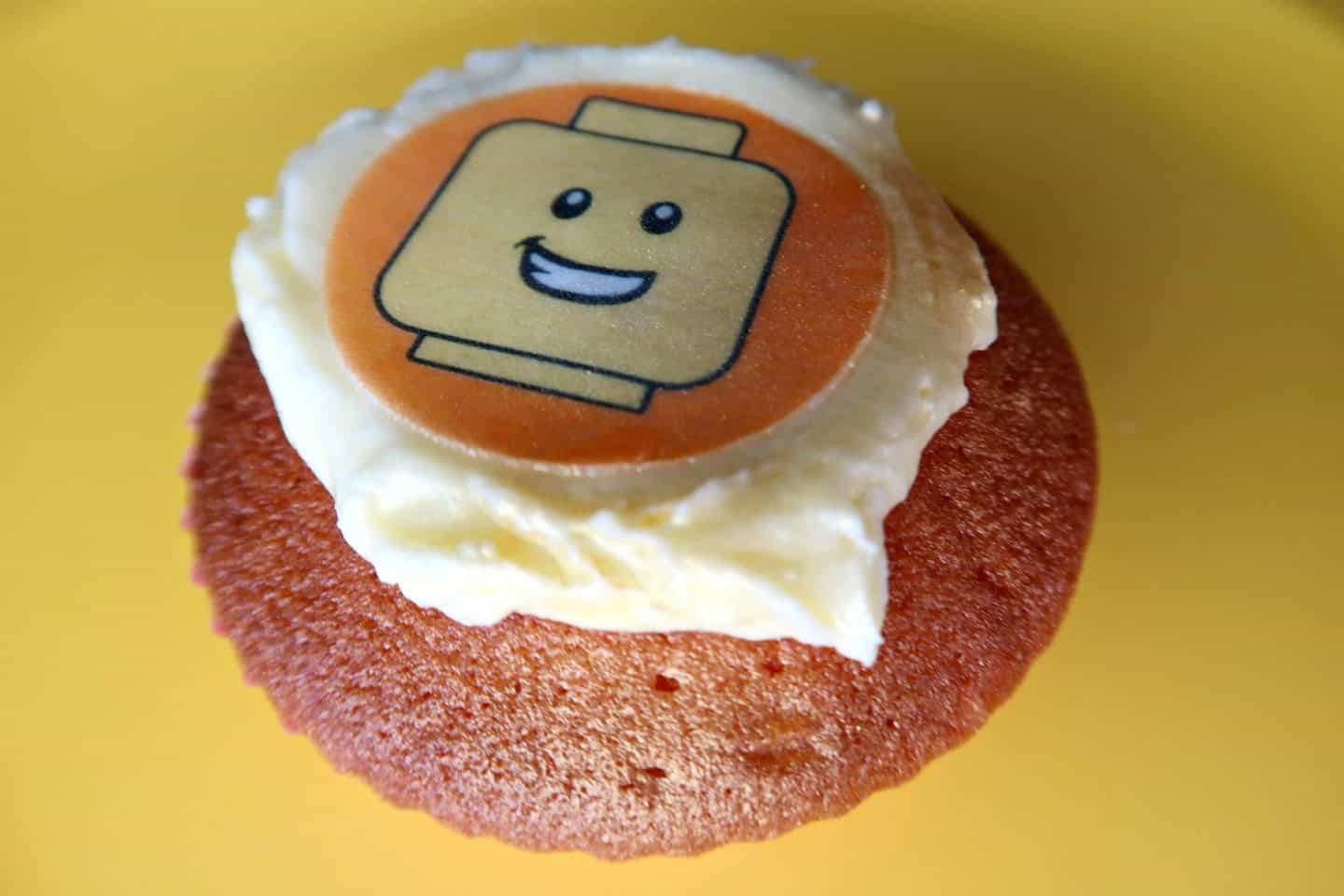 Fairy cake with butter cream and edible Lego head