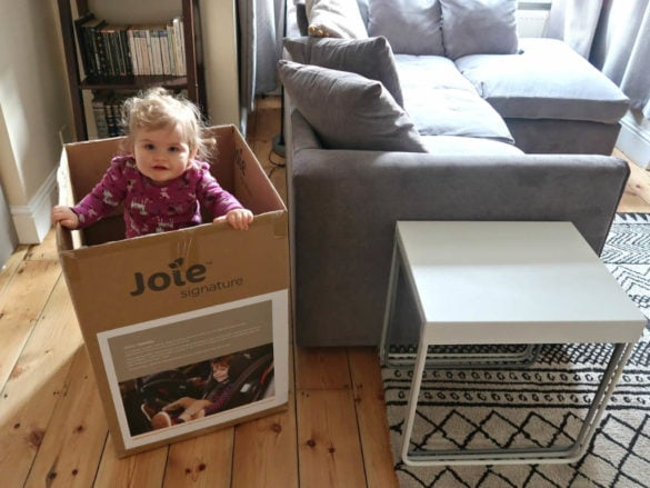 baby standing in Joie everystage box